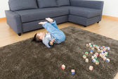 Asian baby boy try to do somersault — Stock Photo