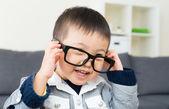Asian little boy wear glasses — Stock Photo