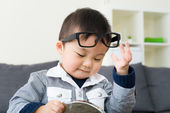 Asian boy wear glasses with mirror — Stock Photo