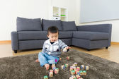 Little boy play toy block at home — Stock Photo