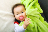 Baby suck with pacifier — Stock Photo