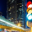 Traffic light in city at night — Stock Photo
