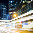 Stock Photo: Modern city with car light
