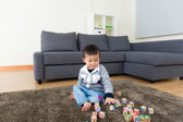 Asian kid playing toy block at home — Stock Photo