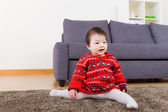 Baby girl doing legs splits on carpet — Stock Photo