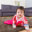 Korebaby with traditional costume crawling on carpet — Stock Photo #39050119