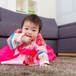 Stock Photo: Korelittle girl crawl at home