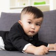 Asian kid using tablet — Stock Photo