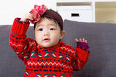 Baby girl with hair accessory — Stock Photo