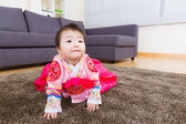 Korean baby with traditional costume looking up — Stock Photo