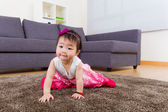 Little girl crawling at home — Stock Photo