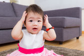 Little girl hand cover ear — Stock Photo
