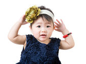 Little girl adjust hair accessory — Stock Photo