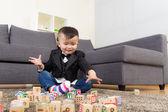 Little boy play toy block — Stock Photo