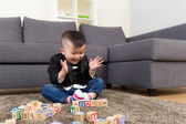 Little boy feeling excited to play toy block — Stock Photo