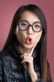 Woman with funny face over red background — Stock Photo