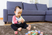 Baby playing toyblock — Stock Photo