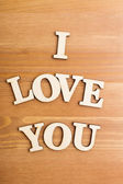 Wooden letters forming phrase I Love You — Stock Photo
