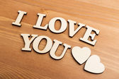 Vintage wooden letters forming with phrase I Love You — Stock Photo