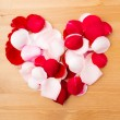 Stock Photo: Rose petal forming heart shape