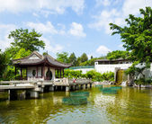 Chinese style pavilion with lake — Stock Photo