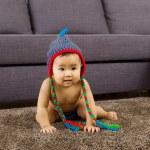 Baby crawling on carpet — Stock Photo #39424073