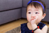 Baby sucking finger in mouth — ストック写真
