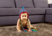 Baby crawling on carpet — Stock Photo