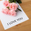 Pink rose with message of I Love You — Stock Photo