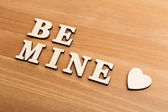 Wooden letters forming be mine — Stock Photo