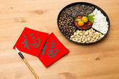 Assorted chinese sytle snack tray and chinese calligraphy — Stock Photo