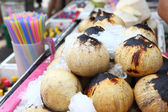 Young coconut drinks on street — Stock Photo
