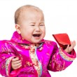 Stock Photo: Chinese baby crying with red pocket