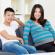 Pregnant woman and husband at home — Stock Photo