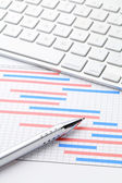 Project plan gantt charts with computer keyboard — Stock Photo