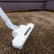 Cleaning carpet with vacuum — Stock Photo #39950443