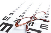 Eyeglasses and eye chart — Photo