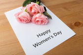 Bouquet of pink roses with happy women day message — Foto Stock