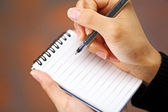 Pen in hand writing — Stock Photo