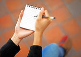 Woman hand jot note — Stock Photo