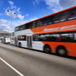 Foto Stock: Fast moving bus on highway