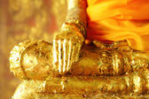 Buddha statue with golden foil — Stock Photo