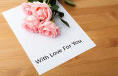 Pink rose and love message — Stok fotoğraf