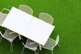 Outdoor chair and table on lawn — Stock Photo