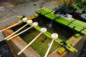 Bamboo ladle in Japan temple — Stock Photo
