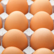 Egg in paper package — Stock Photo