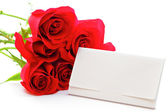 Red rose bouquet and gift card — Stock Photo