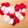 Stock Photo: Rose petal form heart shape