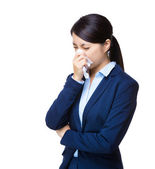 Business woman sneeze — Stock Photo