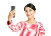 Asian woman take photo by herself — Stock Photo